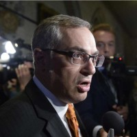 Treasury Board President Tony Clement fields questions in the foyer outside the House of Commons in Ottawa, Monday, May 11, 2015. THE CANADIAN PRESS/Adrian Wyld