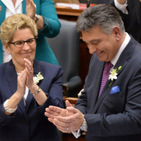 Ontario Finance Minister Charles Sousa receives applause after delivering the provincial budget from Premier Kathleen Wynne and other MPPs at Queen's Park in Toronto on Thursday, April 23, 2015. THE CANADIAN PRESS/Nathan Denette