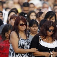 Tina Fontaine, right, walks during a vigil for her daughter, Tina Fontaine, and Faron Hall in Winnipeg, Manitoba, Tuesday, August 19, 2014. THE CANADIAN PRESS/Trevor Hagan ORG XMIT: WPGT122