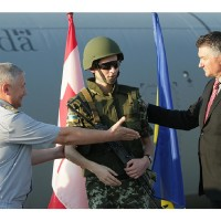 James Bezan, far right, is shown in this Canadian government photo promoting the delivery of surplus Canadian military equipment to Ukraine in August 2014. It cost Canadian taxpayers $1.6 million to transport $5 million worth of equipment to Ukraine by military aircraft. 0827 ukraine