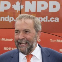 ndp-leader-tom-mulcair-smiles-while-campaigning-in-stratfor
