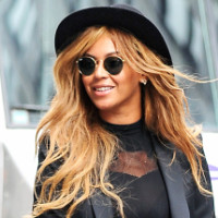 Beyonce looking very stylish rocking a black tuxedo suit with a black fedora holding her Canon 5D Mark III camera in NYC on July 15th, 2015  Pictured: Beyonce Ref: SPL1079237  150715   Picture by: Sharpshooter Images/Splash News  Splash News and Pictures Los Angeles: 310-821-2666 New York: 212-619-2666 London: 870-934-2666 photodesk@splashnews.com