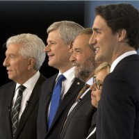Bloc Quebecois Leader Gilles Duceppe, from left to right, Conservative Leader Stephen Harper, NDP Leader Tom Mulcair, Green party Leader Elizabeth May and Liberal Leader Justin Trudeau pose for photos before the French-language leaders' debate Thursday, September 24, 2015, in Montreal. THE CANADIAN PRESS/Adrian Wyld