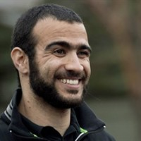 Omar Khadr smiles as he speaks to the media after being granted bail in Edmonton on Thursday, May 7, 2015. Lawyers for former Guantanamo Bay prisoner Omar Khadr are to be in court Friday to argue for an ease in his bail conditions. THE CANADIAN PRESS/Nathan Denette