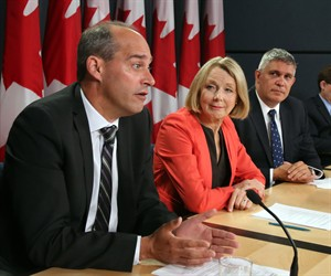 NDP candidate Guy Caron, left to right, NDP industry critic Peggy Nash and candidate Andrew Thomson hold a news conference regarding the release of second quarter GDP numbers from Statistics Canada in Ottawa, Tuesday September 1, 2015. THE CANADIAN PRESS/Fred Chartrand