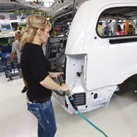 A worker on the production line at Chrysler's assembly plant in Windsor, Ontario, works on one of their new minivans on Tuesday, January 18, 2011.Canadian auto workers' union Unifor predicts that 20,000 auto industry jobs could be lost as a result of the Trans-Pacific Partnership trade deal announced today.THE CANADIAN PRESS/Geoff Robins