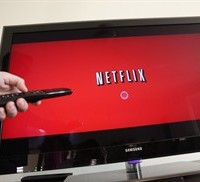 A person uses Netflix in Palo Alto, Calif in this July 20, 2010 file photo. Canadians are paying more for their communications services in a trend driven by increased spending on wireless and Internet packages amid the growing popularity of video streaming services like Netflix. THE CANADIAN PRESS/AP/Paul Sakuma