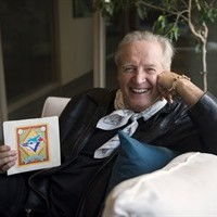 "Jack Lenz, who wrote the Toronto Blue Jays ""OK Blue Jays"" song poses for a photo holding a vinyl of the single, in Toronto, Wednesday, Oct, 7, 2015. THE CANADIAN PRESS/Marta Iwanek"