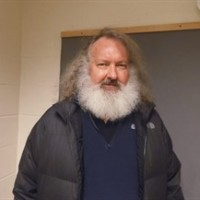 "In a photo provided by the Vermont State Police, actor Randy Quaid stands in the Vermont State Police barracks in St. Albans, Vt., Friday, Oct. 9, 2015. State Police say Quaid has been taken into custody while trying to cross from Canada into the United States. State Police say the ""Independence Day"" actor was detained by troopers at the Highgate Springs port of entry, days after Canadian officials said he would be deported. Quaid is wanted in Santa Barbara, Calif., to face felony vandalism charges filed in 2010 after he and his wife, Evi, were found squatting in a guesthouse of a home they previously owned. (Vermont State Police via AP)"