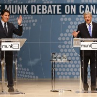 Conservative Leader Stephen Harper, right, and Liberal Leader Justin Trudeau participate in the Munk Debate on Canada's foreign policy in Toronto, on Monday, Sept. 28, 2015. THE CANADIAN PRESS/POOL-Mark Blinch