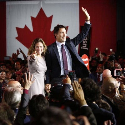 Liberal Party leader Justin Trudeau waves while accompanied by his wife Sophie Gregoire as he gives his victory speech after Canada's federal election in Montreal, Quebec, October 19, 2015. (Jim Young/Reuters)