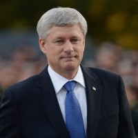 Prime Minister Stephen Harper arrives at a ceremony marking the one-year anniversary of the attack on Parliament hill Thursday Oct. 22, 2015 at the National War Memorial in Ottawa. There are three petitions generating a heated debate on whether the Calgary International Airport should be renamed for outgoing prime minister Stephen J. Harper. THE CANADIAN PRESS/Sean Kilpatrick