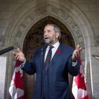 FILE -- NDP Leader Tom Mulcair speaks to reporters in the foyer on Parliament Hill, shortly after addressing his caucus, on Wednesday, Nov. 4, 2015, in Ottawa. (Justin Tang/CP)