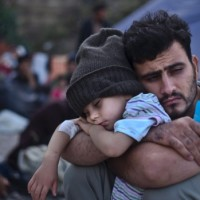 syrian-father-and-son-at-refugee-camp