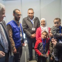 Minister of Immigration, Refugees and Citizenship John McCallum chats with members of a Syrian refugee family being interviewed by authorities in hope of being approved for passage to Canada at a refugee processing centre in Amman, Jordan, on Sunday, Nov. 29, 2015. THE CANADIAN PRESS/Paul Chiasson