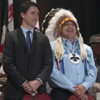 Prime Minister Justin Trudeau and AFN National Chief Perry Bellegarde speak as they arrive at the Assembly of First Nations Special Chiefs Assembly in Gatineau, Tuesday December 8, 2015. THE CANADIAN PRESS/Adrian Wyld