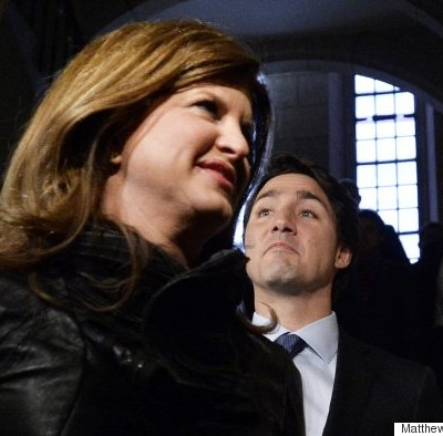 Conservative Interim Leader Rona Ambrose and Prime Minister Justin Trudeau enter the House of Commons on Parliament Hill in Ottawa on Monday, January 25, 2016. THE CANADIAN PRESS IMAGES/Matthew Usherwood
