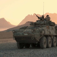 A Canadian LAV (light armoured vehicle) arrives to escort a convoy at a forward operating base near Panjwaii, Afghanistan at sunrise on Nov.26, 2006. 250 retired LAVs are being stripped of their engines and weaponry and being offered as memorials of the war in Afghanistan to communities across Canada. THE CANADIAN PRESS/Bill Graveland