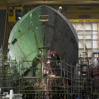 Technicians work on a hull at Halifax Shipyard in Halifax on Thursday, March 7, 2013. Ottawa has signed a $288 million contract for the design of new Arctic offshore patrol ships as part of its shipbuilding procurement project. The Irving-owned shipyard was awarded a large share of a 35-billion-dollar federal procurement project last year. THE CANADIAN PRESS/Andrew Vaughan // 0212 col ivison ORG XMIT: POS2013032812503796