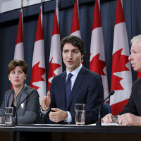 Canada's Prime Minister Justin Trudeau (2nd R) speaks during a news conference with Defence Minister Harjit Sajjan (L), International Development Minister Marie-Claude Bibeau (2nd L) and Foreign Minister Stephane Dion in Ottawa, Canada, February 8, 2016. (Chris Wattie/Reuters)