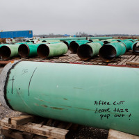 "Pipes sit at the TransCanada Corp. Houston Lateral Project pipe yard in Mont Belvieu, Texas, U.S., on Wednesday, March 5, 2014. Russ Girling, TransCanada Corp. president and chief executive officer, said he remains ""optimistic"" that market forces will see that the embattled Keystone XL oil sands pipeline is built, but the real question is when. Photographer: Scott Dalton/Bloomberg via Getty Images"