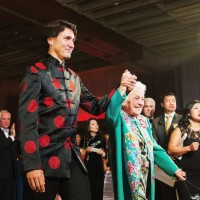 Canadian Prime Minister Justin Trudeau, left, walks hand-in-hand with former Mississauga mayor Hazel McCallion as they attend the 27th Annual Dragon Ball Gala, in celebration of the Chinese New Year, in Toronto on Saturday, Feb. 6, 2016. THE CANADIAN PRESS/Michelle Siu