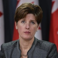 Minister of International Development and La Francophonie Marie-Claude Bibeau speaks to media during a press conference in Ottawa on Monday, February 8, 2016. THE CANADIAN PRESS IMAGES/Matthew Usherwood