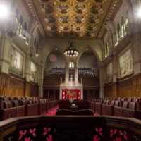 The Senate chamber sits empty on September 12, 2014 in Ottawa. The Senate is staring down the possibility of heading to court over more expense claims just one day after Sen. Mike Duffy's was cleared on 31 charges. THE CANADIAN PRESS/Adrian Wyld ORG XMIT: CPT160