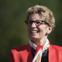 Ontario Premier Kathleen Wynne looks on before making a climate change policy announcement at Evergreen Brickworks in Toronto, Wednesday, June 8, 2016. Wynne says there wouldn't be a new national agreement to enhance the Canada Pension Plan if the province hadn't pushed the issue so hard.THE CANADIAN PRESS/Mark Blinch ORG XMIT: CPT115  0629 ed urback