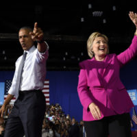 President Barack Obama and Democratic presidential candidate Hillary Clinton wave upon arriving at a campaign event at the Charlotte Convention Center in Charlotte, N.C., Tuesday, July 5, 2016. Obama is spending the afternoon campaigning for Clinton. (AP Photo/Susan Walsh)