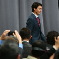 """Justin Trudeau, Canada's prime minister, arrives for a joint news conference with Enrique Pena Nieto, Mexico's president, not pictured, and U.S. President Barack Obama, not pictured, at the National Gallery of Canada during the North American Leaders Summit (NALS) in Ottawa, Ontario, Canada, on Wednesday, June 29, 2016. Leaders from the three Nafta nations """"agree on the need for governments of all major steel-producing countries to make strong and immediate commitments to address the problem of global excess steelmaking capacity,"""" according to a statement from Trudeau. Photographer: Cole Burston/Bloomberg"""