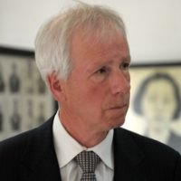 Canadian Foreign Minister Stephane Dion (L) looks at portraits of victims of the Khmer Rouge displayed during his visit at the Tuol Sleng genocide museum in Phnom Penh on September 2, 2016. Dion is in Cambodia for a three-day official visit. / AFP PHOTO / TANG CHHIN SOTHYTANG CHHIN SOTHY/AFP/Getty Images