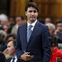 Prime Minster Justin Trudeau stands in the House of Commons during a vote after Question Period. Tuesday October 18, 2016. THE CANADIAN PRESS/Fred Chartrand ORG XMIT: FXC112