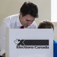 Liberal leader Justin Trudeau carries his vote to the ballot box accompanied by his son Xavier on October 19, 2015 in Montreal. Canadians began voting in general elections Monday, with polls showing Justin Trudeau's Liberal Party positioned to end nine years of Stephen Harper's Tory rule. AFP PHOTO/POOL/PAUL CHIASSONPAUL CHIASSON/AFP/Getty Images