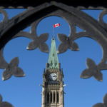 Centre Block's Peace Tower is shown through the gates of Parliament Hill as Finance Minister Jim Flaherty prepares to table the budget on Parliament Hill in Ottawa on Tuesday, Feb. 11, 2014. THE CANADIAN PRESS/Justin Tang