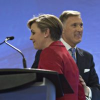 Leadership candidates Kellie Leitch, left, and Maxime Bernier greet each other at the beginning of the Conservative Party French language leadership debate, Tuesday, January 17, 2017 in Quebec City. THE CANADIAN PRESS/Jacques Boissinot