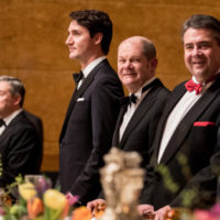 Canadian Prime Minister Justin Trudeau (L), Hamburg's mayor Olaf Scholz and German Foreign Minister Sigmar Gabriel wait ahead the Mattiae meal in Hamburg, northern Germany, on February 17, 2017. Trudeau and Gabriel are honorary guests of the meal that takes place since 1356 by the Mattiae day on February 24. / AFP / dpa / Christian Charisius / Germany OUT        (Photo credit should read CHRISTIAN CHARISIUS/AFP/Getty Images)