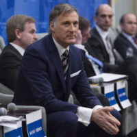 Conservative Party leadership candidate Maxime Bernier listens to presentations at a debate Monday, February 13, 2017 in Montreal. THE CANADIAN PRESS/Paul Chiasson