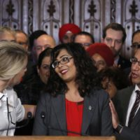Member of Parliament Iqra Khalid is congratulated by colleagues as she makes an announcement about an anti-Islamophobia motion on Parliament Hill in Ottawa on Wednesday, February 15, 2017. THE CANADIAN PRESS/ Patrick Doyle