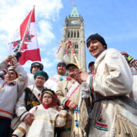 A group of young aboriginal people who travelled 1,600 kilometre on foot from the James Bay Cree community of Whapmagoostui, Quebec celebrate their arrival on Parliament hill in Ottawa, Monday, March 25, 2013. (Fred Chartrand/CP)
